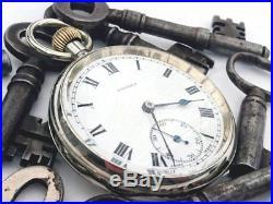 Antique Swiss pocket watch in wooden long-case holder