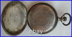 Longines pocket watch silver carved hunter case enamel dial 50 mm. In diameter
